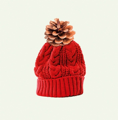 Red bobble hat or knit hat isolated against a white background.